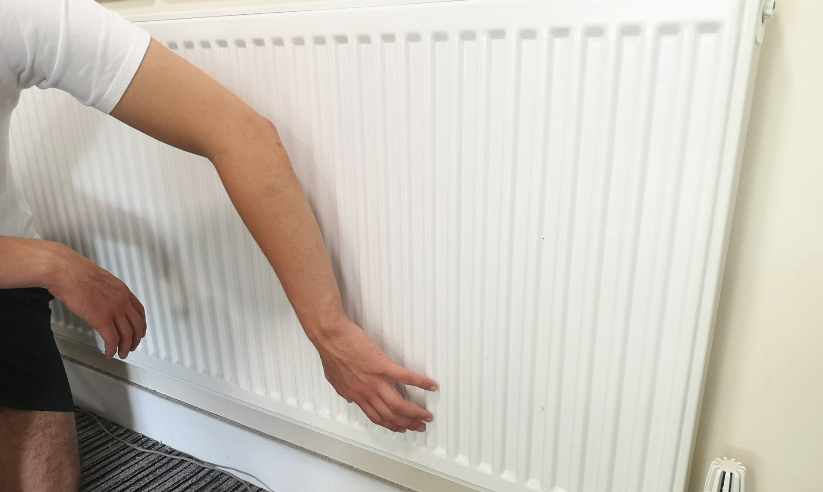 Touch your radiator gently to find the cold patches